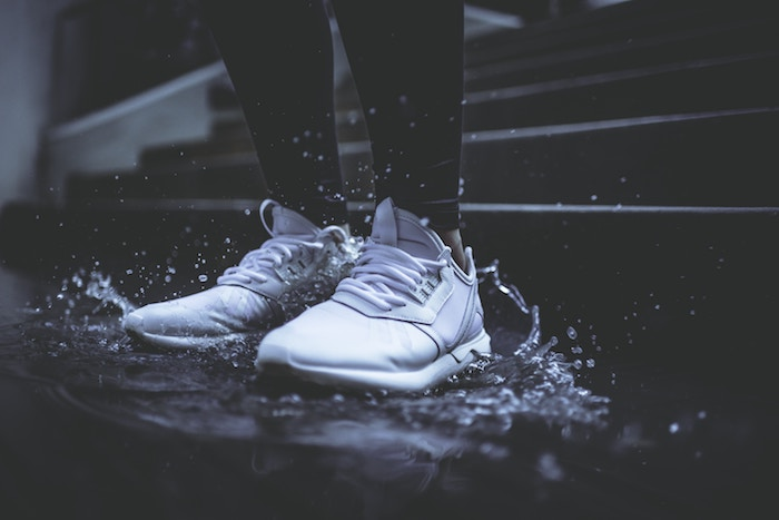 shoes splashing in water