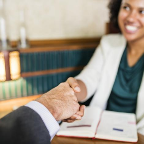 woman shaking hands with a business man