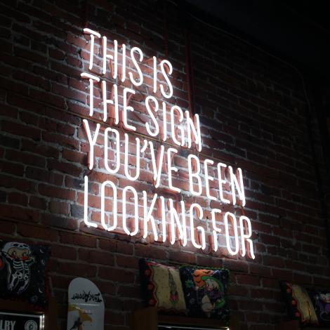 photo of a neon sign that reads 'this is the sign you've been looking for'