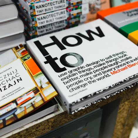 "photo of a stack of books and the main focus is a book that says ""how to"" in large text"